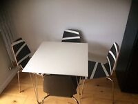Small table with four Ikea chairs.