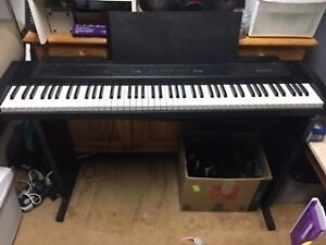 Full 88 key piano keyboard with stand & chair-St. Albert