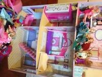 Doll house, barbie dolls clothes and accessories for sale...£30.00