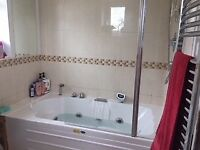 Jacuzzi bath, shower and screen, towel rail and sink