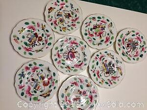Set of eight hand painted porcelain small plates