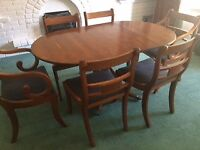 Yew veneer dining table and six chairs