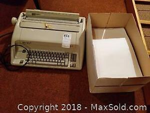 Electric typewriter And Paper -B