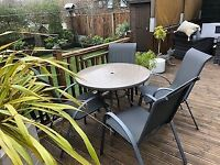 Garden glass table and 4 chairs