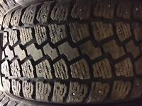 Four 205/55R16 studded winter tires - $150.00