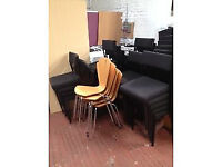 Black stackable fabric chairs on metal frame