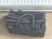 Small dark blue 'Carlton' travel bag