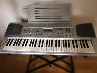 Casio CTK-591 Electronic Keyboard with 61 keys very good condition with stand and instruction book