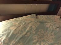 brown wooden double bed frame