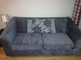 Two seater spacious sofa also a sofa bed in excellent condition for sale