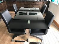 Black Glass and Silver Dining Table plus 4 chairs (2 white chairs can be purchased separately)