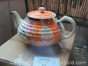 Beautiful Vintage ceramic and silver Radnor teapot