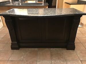 Maple Kitchen with island 60 inch glass table and full granite