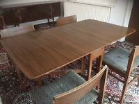 Mid-Century polished dining table and 4 chairs.