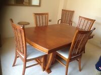 Extendable dining table with 6 chairs. Very good condition.