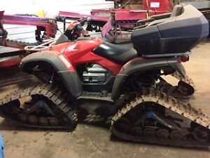 Honda Rincon ATV with tracks and wheels