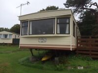 Static Cosalt Coaster 6 berth caravan in good condition currently located on Loch Sween, Argyll.