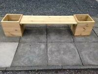 bench with garden planters on sides