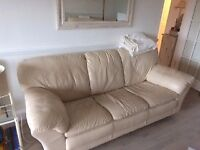 Beautiful leather settee (3 seaters) and matching armchair, cream colour, good quality and stilish