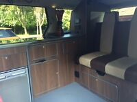 High spec campervan including full kitchen, central heating and pop up roof suitable for 4 people