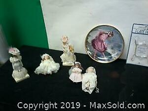 Collectors plate and porcelain dolls.