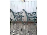 pair of metal ornate bench ends
