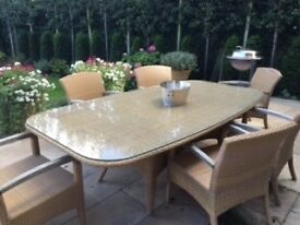 All weather Gloster cane and glass patio table with six chairs