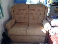 2 seater sofa, high back, dark cream floral pattern, meets fire regs