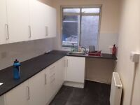 Town center, Bridge street, 1st floor flat with one bedroom. Fitted Kitchen. Large bathroom