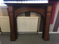 2 wooden fire surrounds