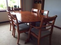 Nathan Yew extending table with six chairs and matching sideboard