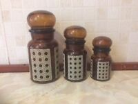 Vintage amber glass storage jars with bubble tops. Made in Belgium.