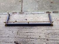 Black metal hearth surround with brass top bar. Variable length.