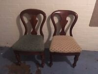 Two dark wood chairs