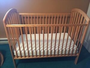 Wooden Baby Crib and Mattress by Stork Craft Canada