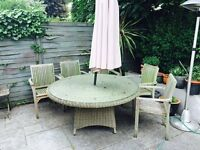 Outdoor large rattan round table (6 seater) with tempered safety glass table top.
