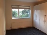2 bed 1st floor flat with double glazing, central heating, parking and recently decorated