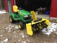 For sale 2012 John Deere X720 lawn tractor with attachments.