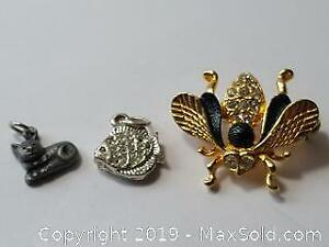 Gold toned Bumble Bee With Rhinestones Pin with silvertone fish and pewter cat