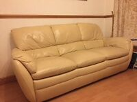 Three piece leather suite, cream, used.