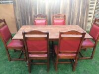 Fantastic solid oak chairs with 6 red leather padding and matching oak table