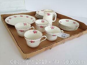 Matching tea cups, saucers, milk pitcher and plates. B