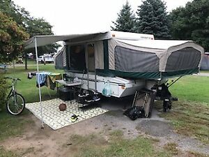 2003 Starcraft 10 foot pop up trailer with storage box on front