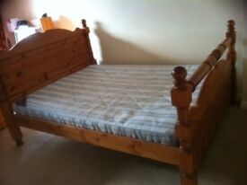 Large wooden double bed frame, mattress and head board