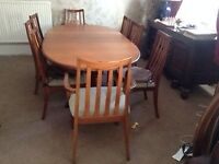 Teak Dining table and matching 8 chairs