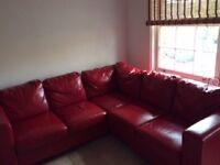 Corner red leather sofa