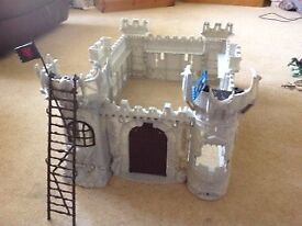 Toy castle and knight, horses, weapons accessories. Plastic.