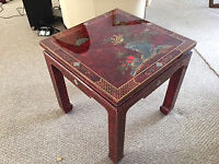 Red lacquer end table with inlaid design