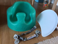 Green bumbo seat with tray and safety straps