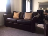 Two Medium Chocolate Brown Leather Sofas. Good condition, Sold as pair or individually